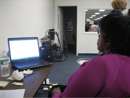 Common Council Member Carolyn McLaughlin (Ward 2) Watches The Laptop