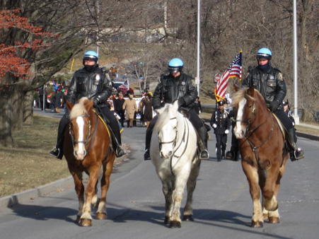 Cold Cops On Horses Leading The March