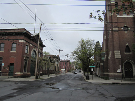 Looking Up Fourth Avenue Toward south Pearl Street, St. Francis Church At Right, St. John's/St. Ann's Institute And Bathhouse #2 At Left