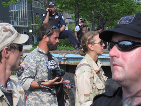 Shameful Chicago Surveillance Cop Peeping At Our Brave Soldiers As They March