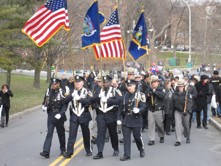 The State Police Color Guard Leads The March