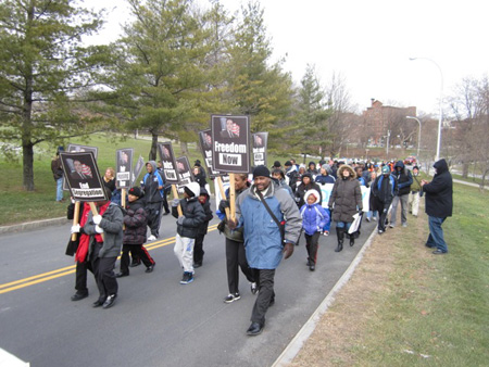 Marchers Carry Safe Generic Signs