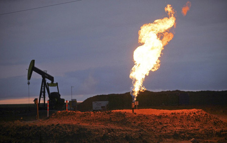 Bakken Oil Field In North Dakota, Rig And Flare Burning Off Natural Gas