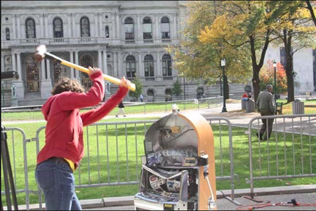 The Right Idea: Bill Sisk Of The Rockefeller Institute Smashes A Slot Machine In Front Of The State Capitol, October 2013.  The Corporate Media Did Not Report This Demonstration