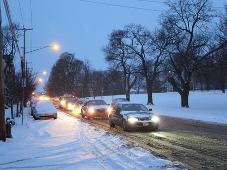 Cars At A Traffic Light On Morton Avenue, January Snow At Dawn
