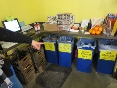 Recycling Cans Behind The Service Desk At Honest Weight Coop
