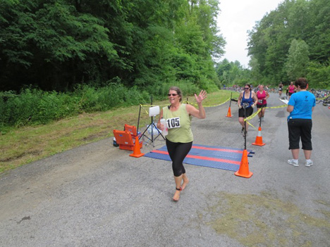 Claire Nolan Arriving In Guilderland, She Did The Entire Triathlon Barefooted