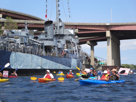 Paddling Past The USS Slater