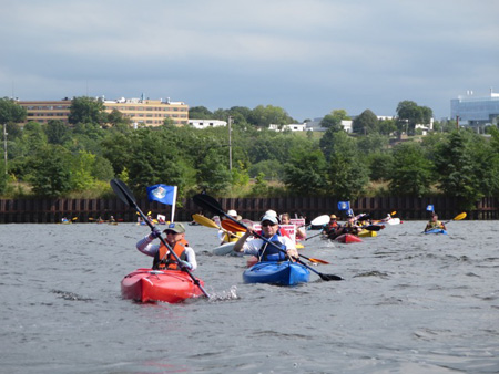 A Brief Line Of Kayaks And Canoes Across The Hudson