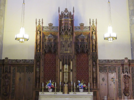 The Carved Wooden Cross Behind The Altar