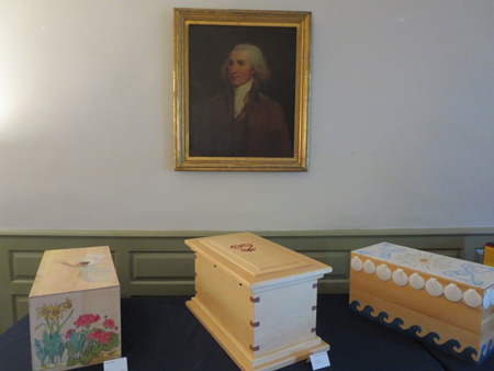 New Caskets Containing The Remains Of Three Of Philip Schuyler's Slaves Beneath A Portrait Of Their Master Inside His Albany House, April 2016