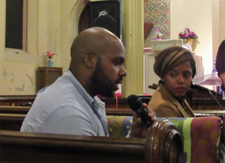 Jahkeen Hoke Speaks While Common Council Member Dorcey Applyrs Listens