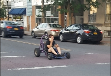 Kid with An Unlicensed Go-Cart (Talking On A Phone!) Photographed On Delaware Avenue At Marinello Terrace, July 2018